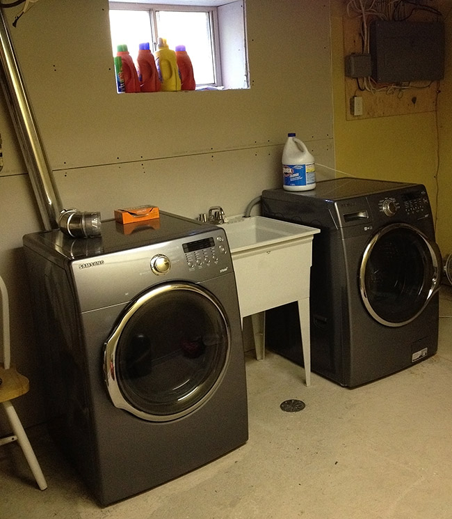 unfinished laundry room in basement