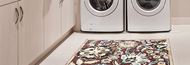 Floral area rug in laundry room.