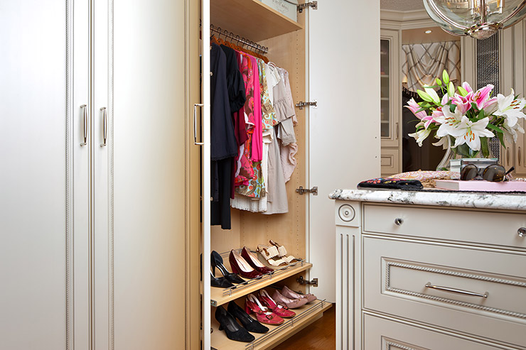 Standard closet with hanging rod and shoe rack.