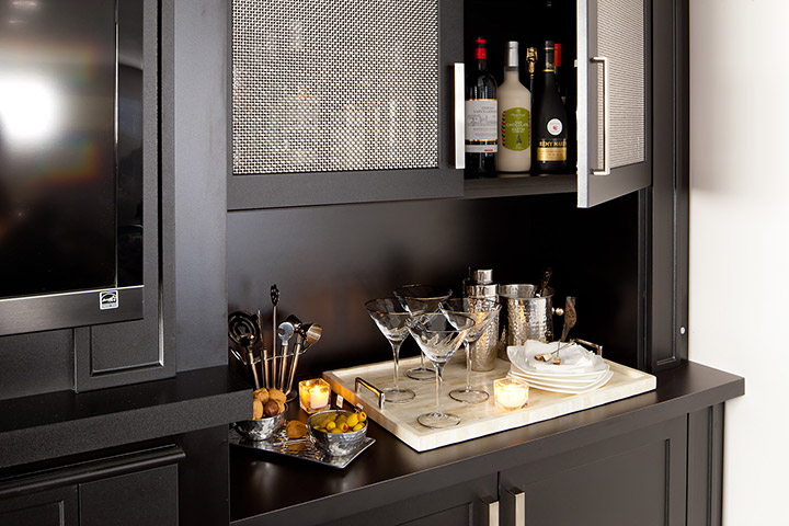 Liquor cabinet and serving area built in to an entertainment unit.
