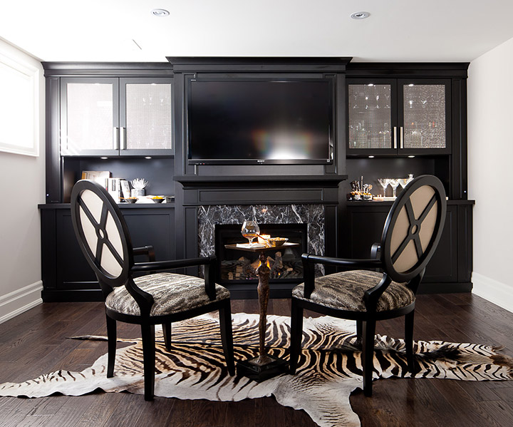 Entertainment unit with mini-bar, home theatre and fireplace.