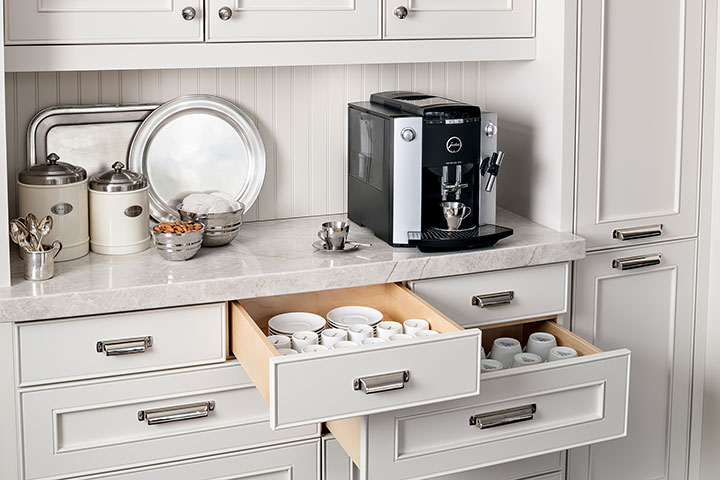 Custom kitchen cabinetry for storing coffee and tea supplies.