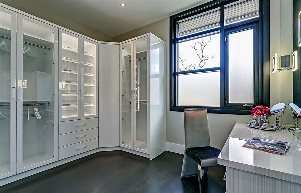 White contemporary master closet.