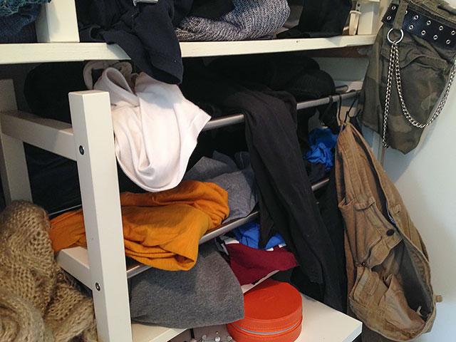 Messy bedroom closet.