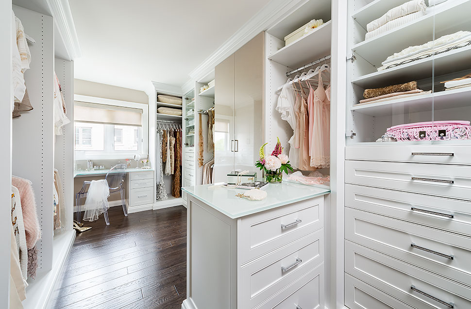 White dressing room walk-in closet with plenty or storage.