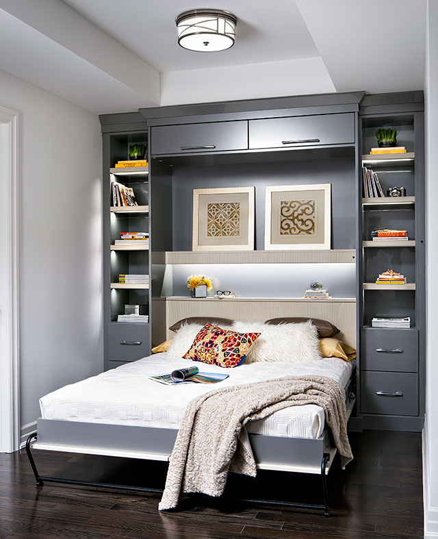 A modern wall bed creates an instant guest room in a condo.