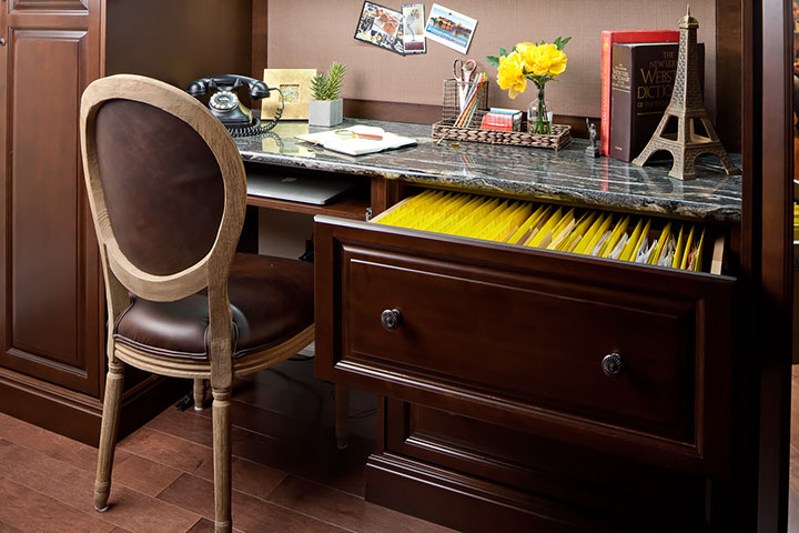 Eliminate home office clutter with a filing cabinet and a clean desk.
