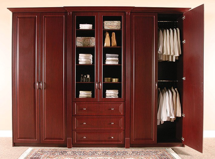 Dark wood wardrobe with plenty of storage space.