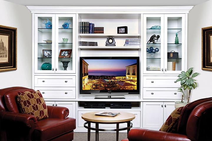 White entertainment unit with plenty of storage.