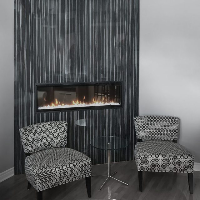 electric fireplaces feature wall two chairs and glass table