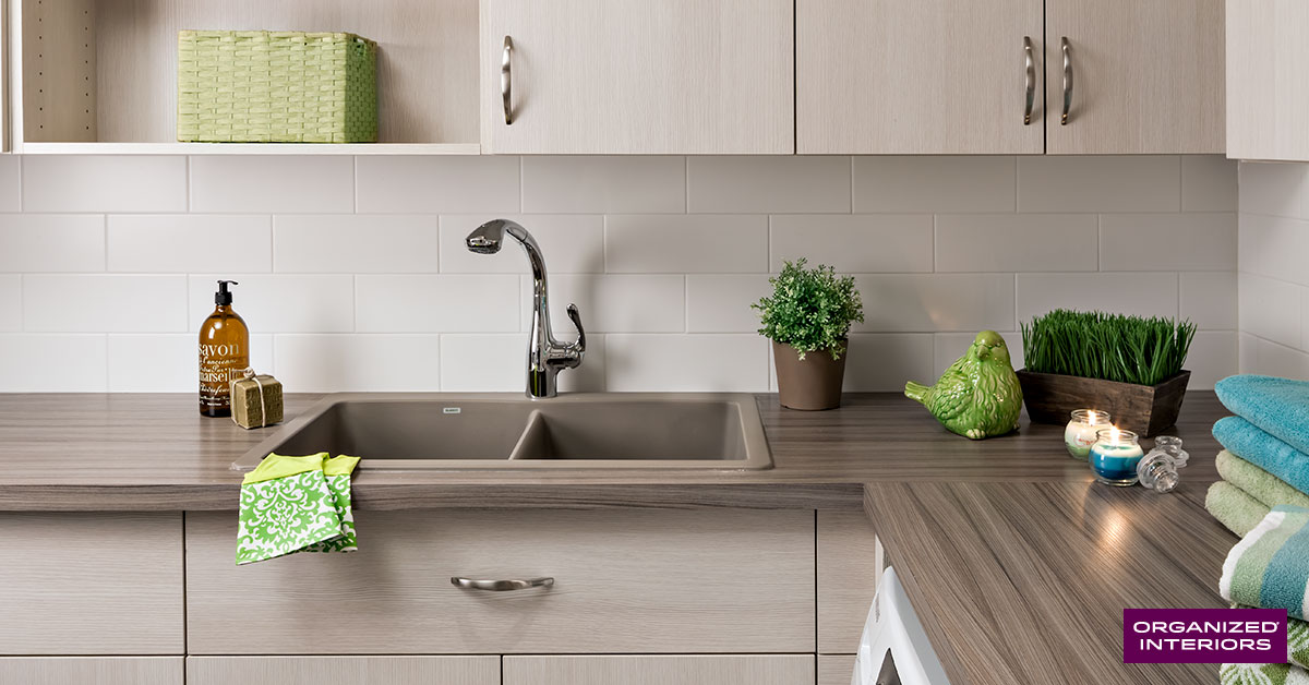 laundry room sink, countertop, custom cabinetry, green gloves, folded towels
