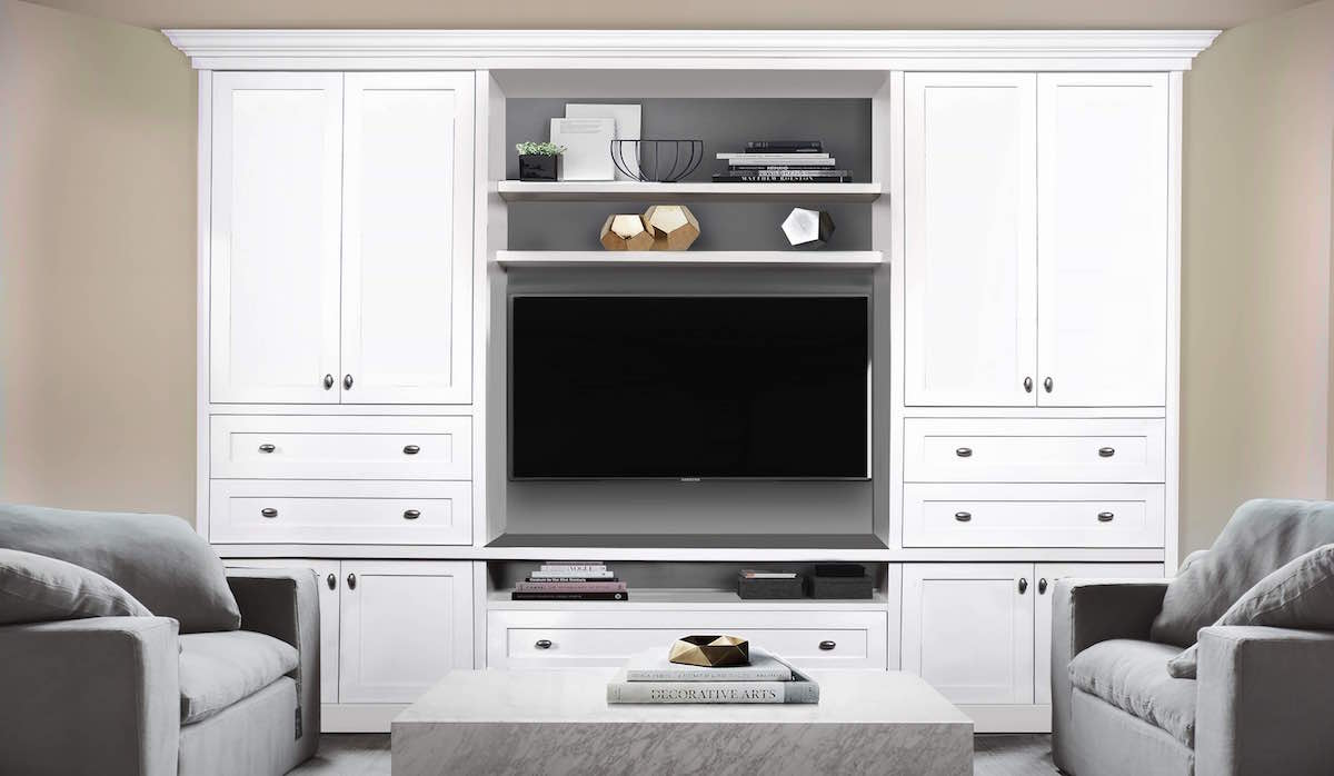 white home entertainment centre with 2 chairs