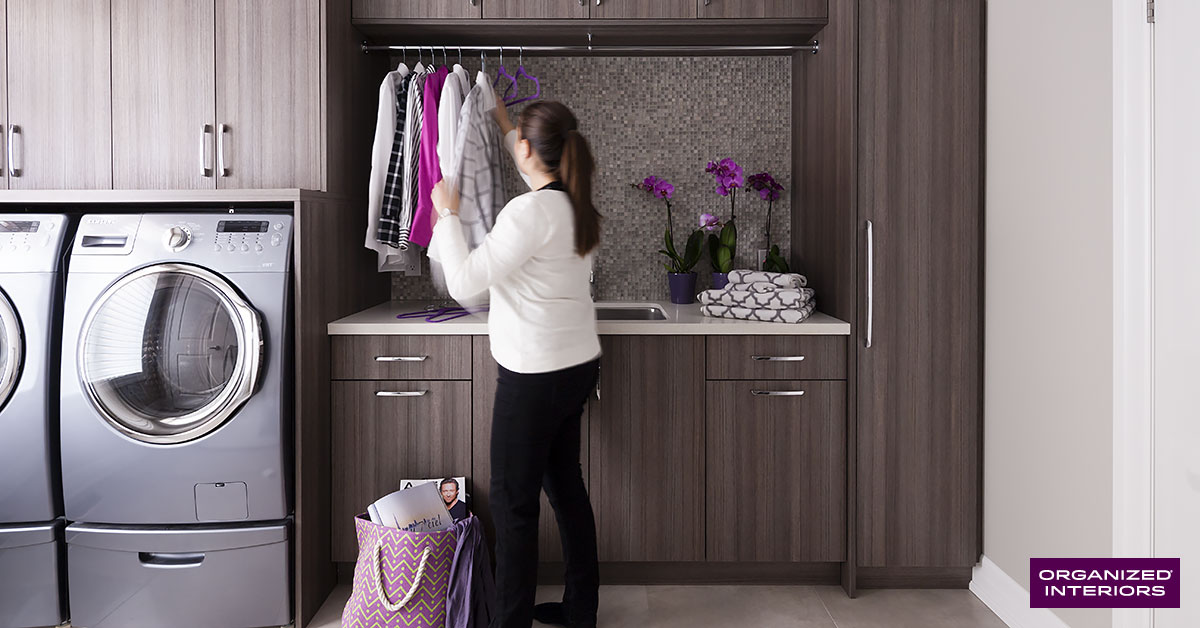 laundry room organization, woman hanging clothes
