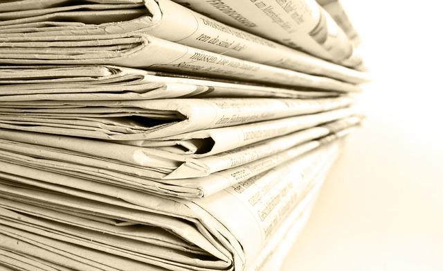 closet clutter newspaper stack