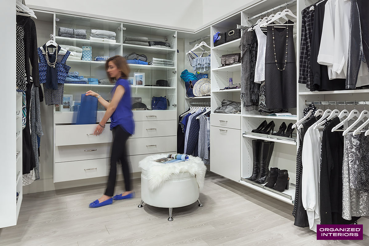organize your home, woman in walk-in closet