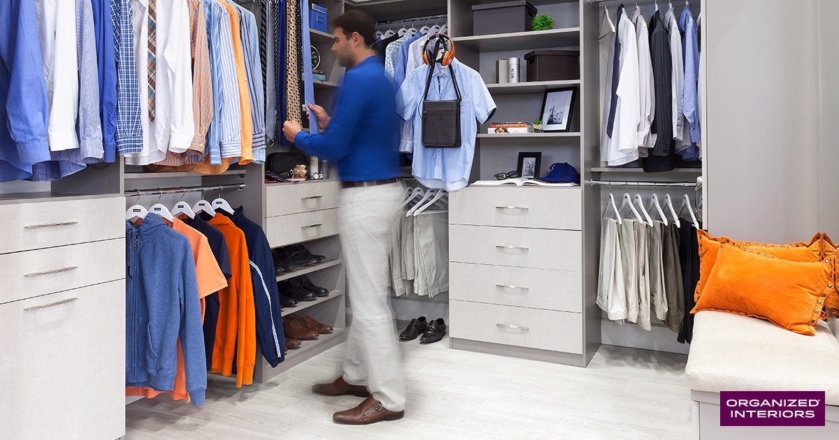 Walk-in closet, man in blue shirt.