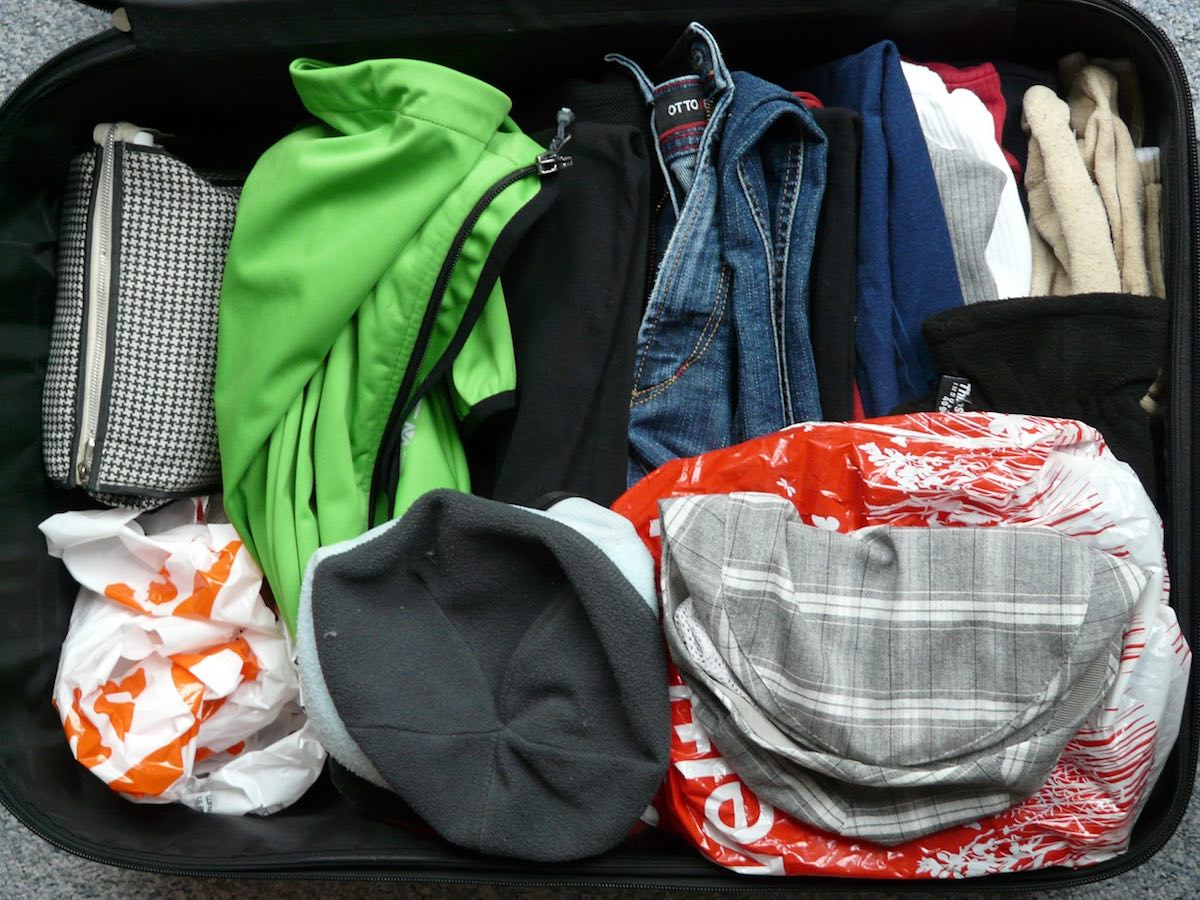 clothes in open suitcase, post-vacation fatigue