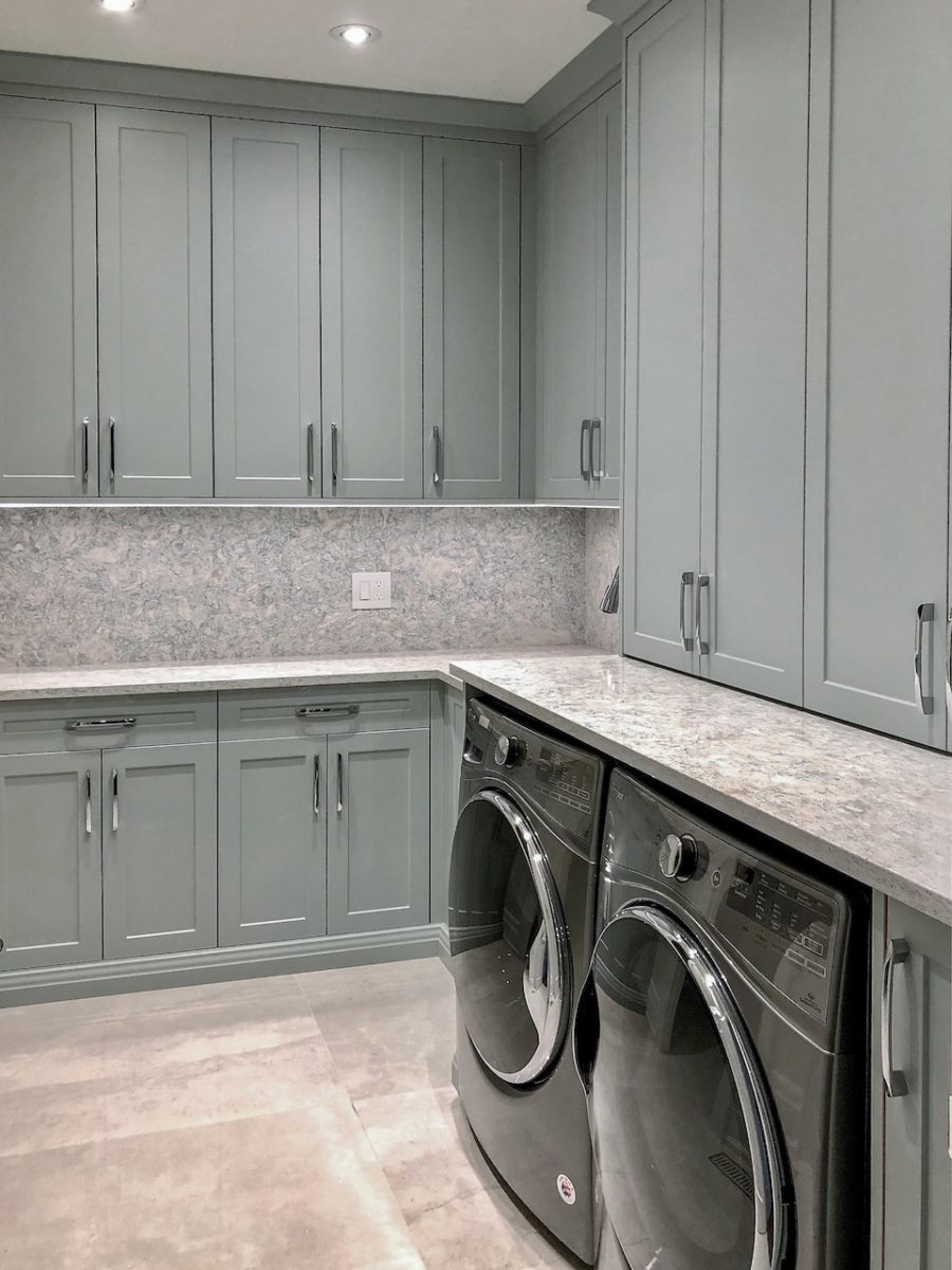 bright laundry room with gray cabinets