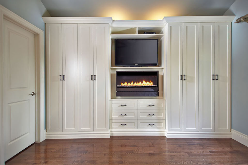 built-in wall unit with tv, fireplace, wardrobes