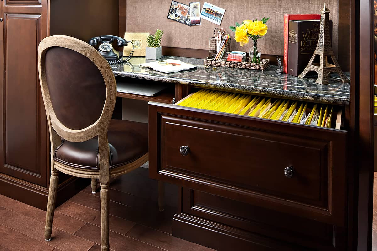 dark desk and cabinetry for home office and single chair