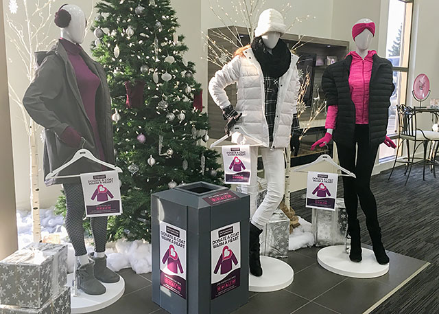 Coat donation box display in Organized Interiors showroom.